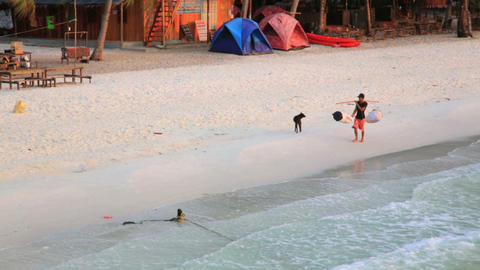 KOH RONG, CAMBODIA - MARCH 2014: nworker on beach Stock Video Footage