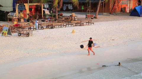 KOH RONG, CAMBODIA - MARCH 2014: nworker on beach Footage