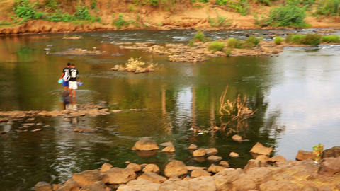 TAD LO, LAOS - MARCH 2014: Women washing clothes a Footage