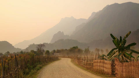 Sunset at limestone mountains of Vang Vieng, Laos Footage