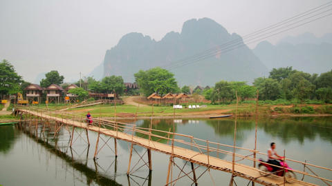 people passing bamboo bridge on limestone mountain Stock Video Footage
