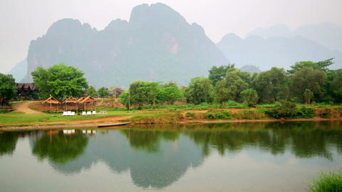 Morning at limestone mountains of Vang Vieng villa Stock Video Footage