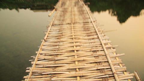walking on dangerous bamboo bridge, laos Footage