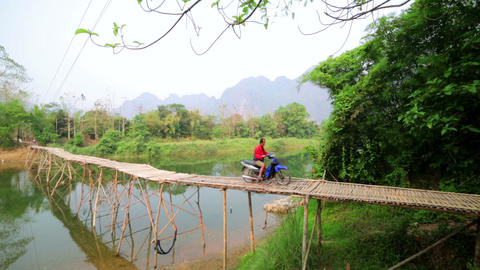 VANG VIENG, LAOS - APRIL 2014: passing bamboo brid Footage