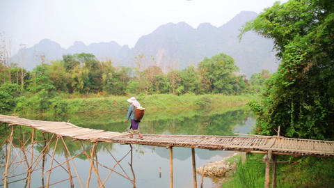VANG VIENG, LAOS - APRIL 2014: crossing river on b Footage