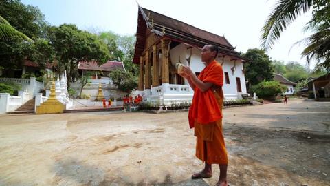 LUANG PRABANG, LAOS - APRIL 2014: monk libaretes b Stock Video Footage