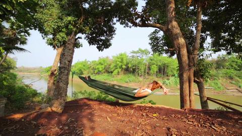tourist girl sleeping on hammock, luang prabang, l Footage