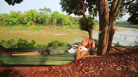 tourist girl sleeping on hammock, luang prabang, l Footage