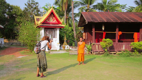 LUANG PRABANG, LAOS - APRIL 2014: tourist taking p Footage