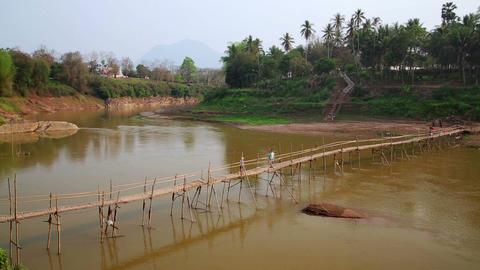 People crossing river on bamboo bridge, luang prab Footage