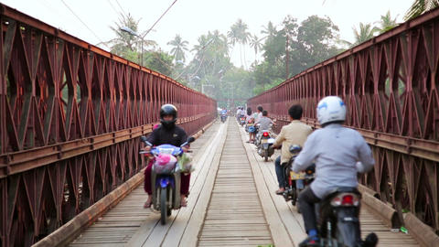 LUANG PRABANG, LAOS - APRIL 2014: motorbikes cross Footage