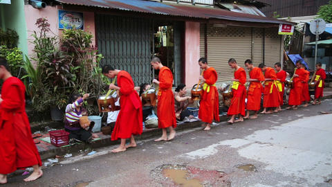 LUANG PRABANG, LAOS - APRIL 2014: people give rice Footage