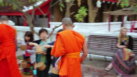 LUANG PRABANG, LAOS - APRIL 2014: people give rice Stock Video Footage