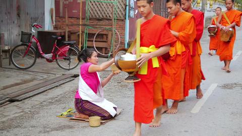 LUANG PRABANG, LAOS - APRIL 2014: people give rice Footage
