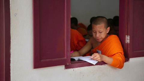 LUANG PRABANG, LAOS - APRIL 2014: buddhist monk sc Stock Video Footage