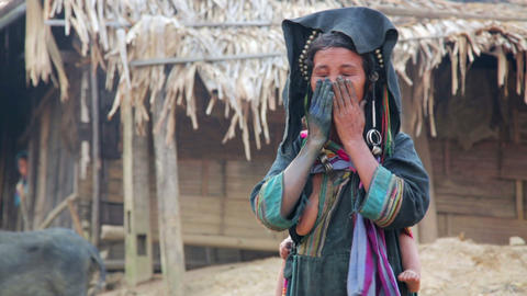 PONGSALI, LAOS - APRIL 2014: native Akha woman car Footage
