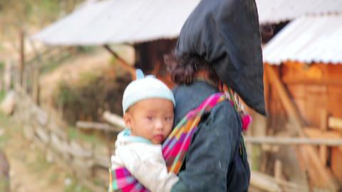 PONGSALI, LAOS - APRIL 2014: native Akha woman car Stock Video Footage