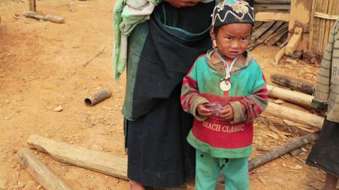 PONGSALI, LAOS - APRIL 2014: native Akha woman car Footage
