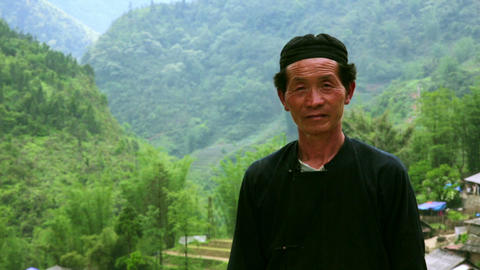 SAPA, VIETNAM - MAY 2014: native Akha man posing Footage
