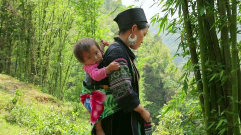 SAPA, VIETNAM - MAY 2014: tribal native Akha woman Footage