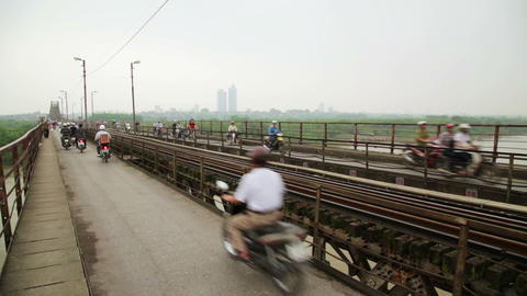 HANOI, VIETNAM - MAY 2014: Motorbikes Passing Iron stock footage