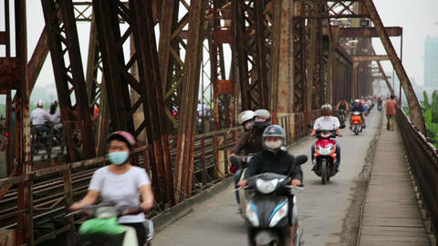 HANOI, VIETNAM - MAY 2014: Motorbikes Passing Iron stock footage