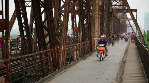 HANOI, VIETNAM - MAY 2014: motorbikes passing iron Stock Video Footage