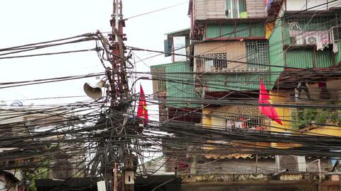 HANOI, VIETNAM - MAY 2014: Slums with messy electr Stock Video Footage