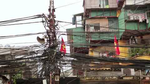 HANOI, VIETNAM - MAY 2014: Slums with messy electr Stock Video Footage