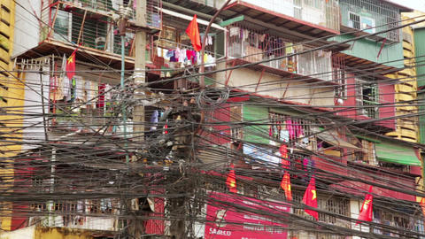 HANOI, VIETNAM - MAY 2014: Slums with messy electr Footage