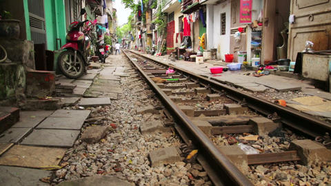 HANOI, VIETNAM - MAY 2014: train passing through s Stock Video Footage