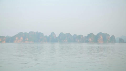 Zoom out - limestone mountain islands, Halong Bay, Footage