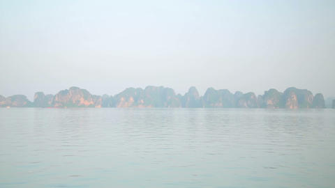 Zoom out - limestone mountain islands, Halong Bay, Stock Video Footage