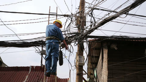 electrician fixing, repairing messy electric cable Footage