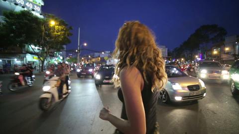 SAIGON, VIETNAM - MAY 2014: woman crossing street Footage