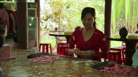 MEKONG DELTA, VIETNAM - MAY 2014: Coconut candy ma Footage