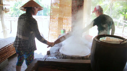 MEKONG DELTA, VIETNAM - MAY 2014: noodle makers Stock Video Footage