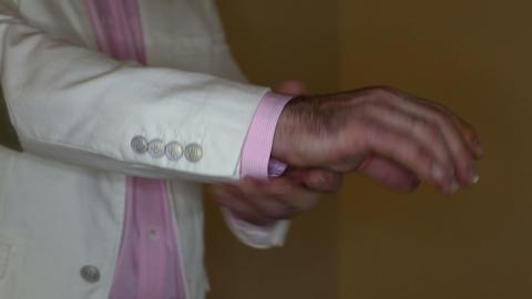 man adjusts his cufflinks Stock Video Footage