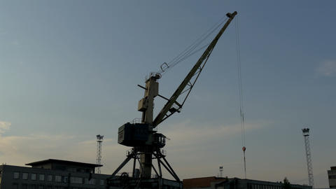 Big crane on standby on a dusky afternoon in the p Stock Video Footage