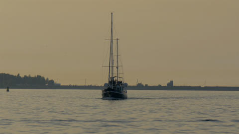 A small yacht on sail on the ocean water GH4 4K Stock Video Footage