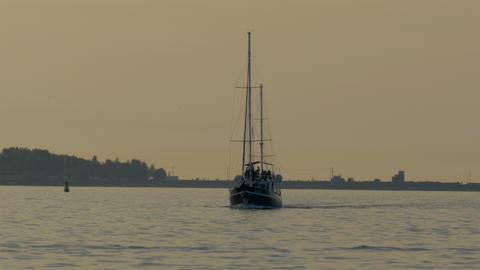 A small yacht on sail on the ocean water GH4 4K Footage