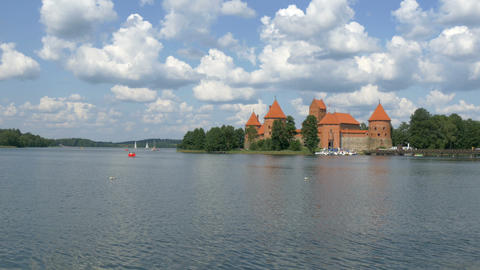 A red medieval castle in Trakai Lithuania GH4 4K U Stock Video Footage