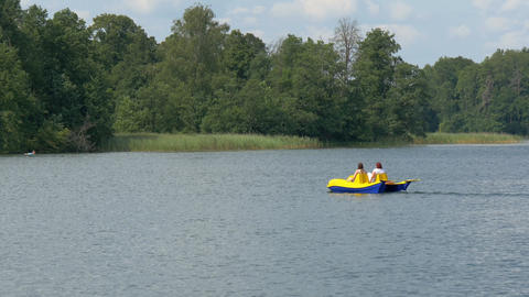 Two Tourist Paddling The Water Bicycle In The Lake stock footage