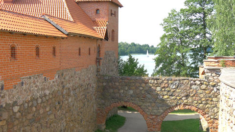 The view outside the old castle with lake behind i Stock Video Footage