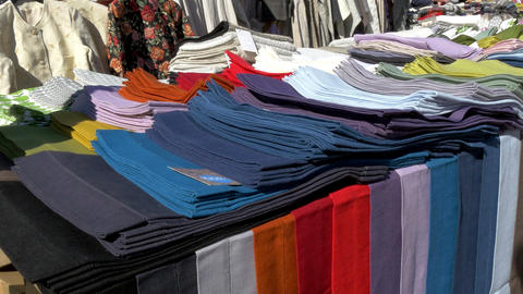 Colorful clothes being displayed on the street of  Footage