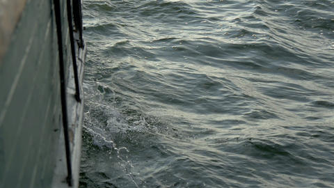 Sea water is waving and bilging with the big ship  Footage