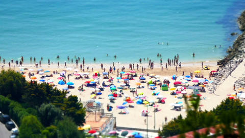 Miniature Time Lapse of People Moving on Beach Stock Video Footage