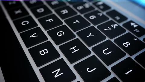 Closeup of laptop's keyboard pan Footage