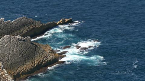 Shot of Waves Breaking onto Rocks Footage