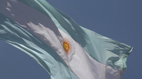 004 Argentina flag on blue sky , slowmotion Stock Video Footage